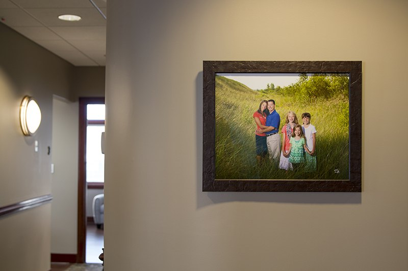 Lakewinds Dental Centre hallway with a framed portrait of Dr. Jason Martin's family